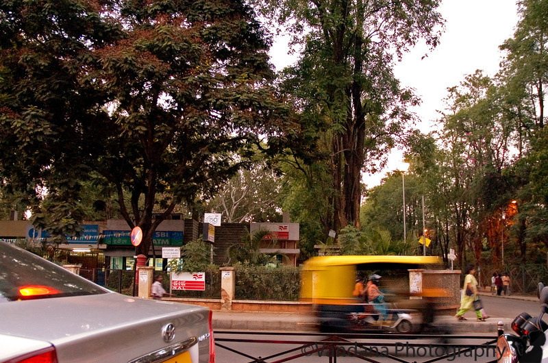 April 18, 2006 - an afternoon flight to Bangalore. Better weather,greener, worse traffic than Delhi! this, taken from the car which was at its perennial stop at a traffic jam. An auto-rickshaw or three wheeler on the move.