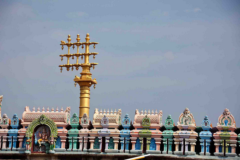 """Ornate brass """"flagpole"""" is common to most temples, but no two are alike."""