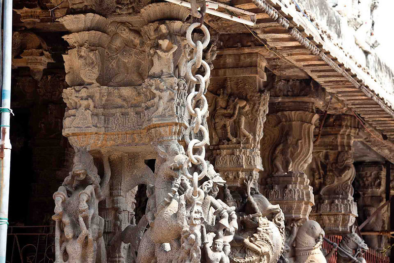 The entire temple, including the chains hanging here and in other pictures, are chisled from the single, huge, block of stone.