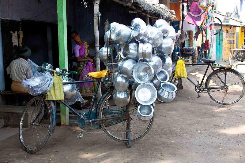 Vendor of aluminum pots.