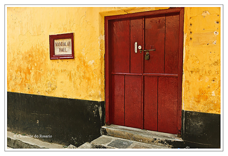 Building with a yellow wall and red door in Cochin, Kerala<br /> File Ref: Kerala-2006 041R 237