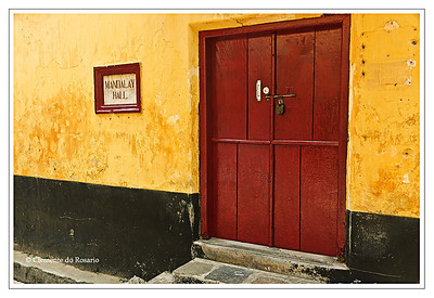 Building with a yellow wall and red door in Cochin, Kerala File Ref: Kerala-2006 041R 237