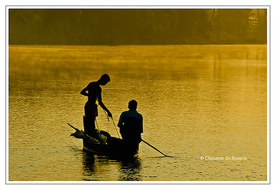 Fishermen silhouetted against the golden light of dawn in the backwaters of Kerala, India File Ref: Kerala-2006 177R
