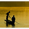 Fishermen silhouetted against the golden light of dawn in the backwaters of Kerala, India<br /> File Ref: Kerala-2006 177R