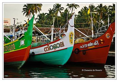 Brightly painted fishing trawlers docked in Cochin, Kerala, India File Ref: Kerala-2006 074R