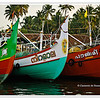 Brightly painted fishing trawlers docked in Cochin, Kerala, India<br /> File Ref: Kerala-2006 074R