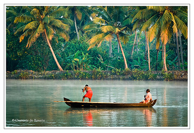 Fishermen in the backwaters of Kerela with palm trees and lush greenery in the background. File Ref: Kerala-2006 161R