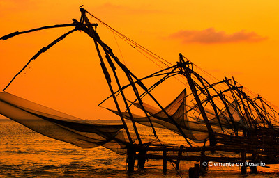 Silhouetted Chinese Fishing Nets at sunset in Fort Cochin, Kerala, India File Ref: Kerala-2006 085R 1517 1518