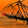 Silhouetted Chinese Fishing Nets at sunset in Fort Cochin, Kerala, India<br /> File Ref: Kerala-2006 096R 1519