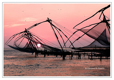 Silhouetted Chinese Fishing Nets at sunset in Fort Cochin, Kerala, India File Ref:Kerala-2006 094R-F.jp