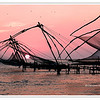 Silhouetted Chinese Fishing Nets at sunset in Fort Cochin, Kerala, India<br /> File Ref:Kerala-2006 094R-F.jp