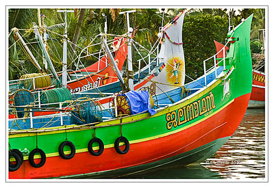Brightly painted fishing trawlers docked in Cochin, Kerala, India File Ref: Kerala-2006 056R