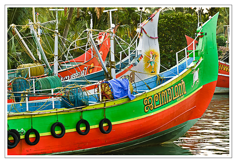 Brightly painted fishing trawlers docked in Cochin, Kerala, India<br /> File Ref: Kerala-2006 056R