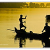 Fishermen silhouetted against the golden light of dawn in the backwaters of Kerala, India<br /> File Ref: Kerala-2006 186R 239