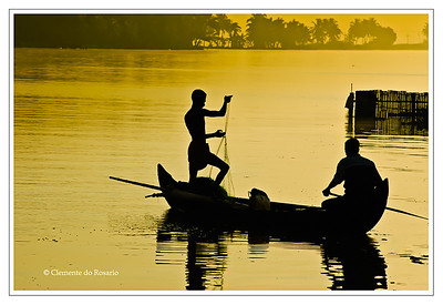 Fishermen silhouetted against the golden light of dawn in the backwaters of Kerala, India File Ref: Kerala-2006 186R 239