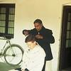 All Gropper getting his hair cut on the veranda of our lodgings in Kenpur.