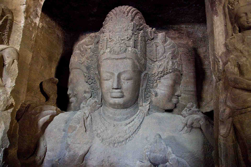 The famous 3-headed, 18' tall, Shiva, creator, destroyer, and preserver of the Universe. All carved out of the single block of basalt that makes up the entire temple.