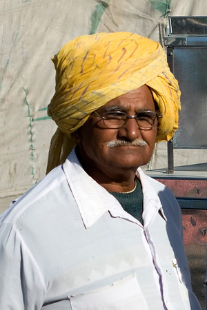 Portrait of an Indian man at the fair.  Copyright for this photo belongs to Lesley Bray.