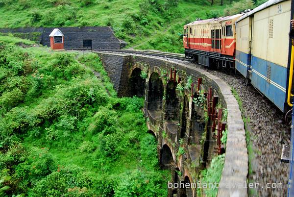 The Shimla Toy Train crossing a bridge.
