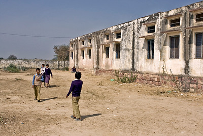 At the rear of the school - their was no grass to be seen either back or front of the school.