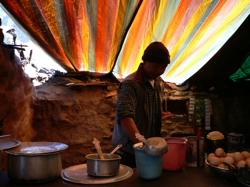 Chandra Dhaba, Batal.<br />  <br /> A little outpost where the road forks into two: one headed towards Lake Chandratal and the other to Spiti. <br /> <br /> This cook at 'Chandra dhaba' is of Tibetan origin. He served up some tantalizing eggs with daal and rice. It was a very welcome treat - after 6 hours of a very dusty and bumpy journey.