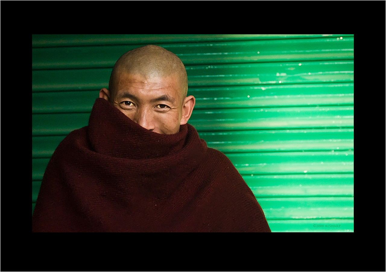 I think this guy was posing as a monk. I have no idea why. Maybe he was some kind of undercover dude. We were fortunate to be in McLeod Ganj during His Holiness' teachings so the town was filled with blissed out monks, true seekers and wannabes from all around the world. I found this guy hanging around at the bottom of our street. At first he was reluctant to have his photo taken but then relented when it looked like he was attracting attention. I have no idea what he was doing he was way too well outfitted to be a poor monk, new western hiking boots, heavy wool cape dyed the wrong color.<br /> Anyway, he had great penetrating eyes. edit