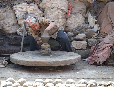 Working potter with kick wheel