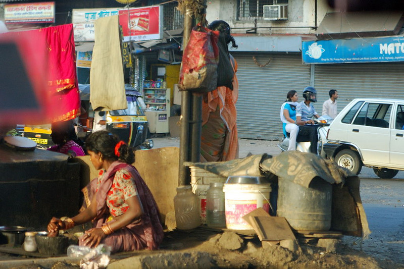 Mumbai. A woman who appears to live under the Freeway.  We drove by twice, a week apart, and I saw her in the exact same place both times.