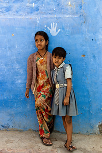Girls in front of a Blue Wall.  Jodhpur, India.