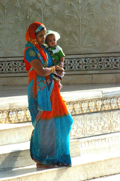 Indian woman with a baby. At the Taj Mahal.