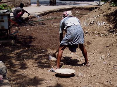 Day laborers preparing for a new sidewalk