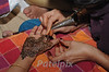"Application of ""Mehndi"" (henna)  ---  part of the excitement, color and beauty of an Indian wedding.  Mumbai 2011"