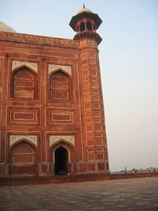 At the west side of the Taj Mahal itself sits a red sandstone mosque. During the Mughal period (from Humayun through Aurangzeb) the building material of preference went from all red sandstone to all white marble. Here is a good example of typical Mughal architecture using red sandstone with white marble accents.