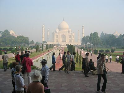 The Taj Mahal in the distance, from the gate, at mid-morning.