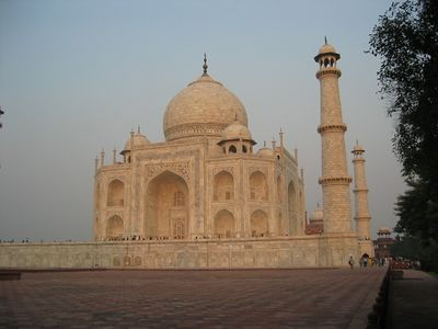 A view from the east. The tomb was built by more than 20,000 artisans and workmen over a 22-year period; at the gate, there are twenty-two domes, one for each year of its building, and only from a certain vantage point on the Taj Mahal's platform can one view all 22 of the towers.