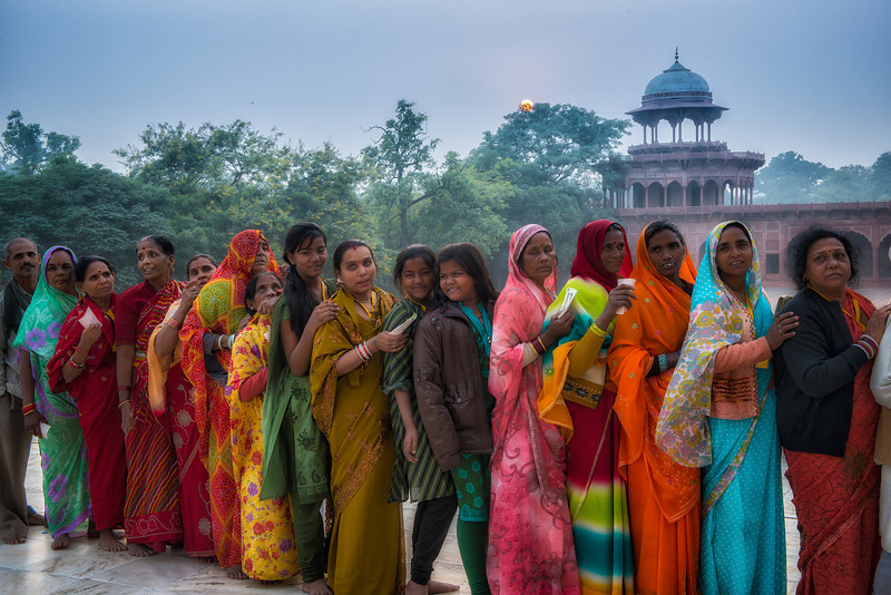 Indian tourists standing in line to get into the Taj Mahal.