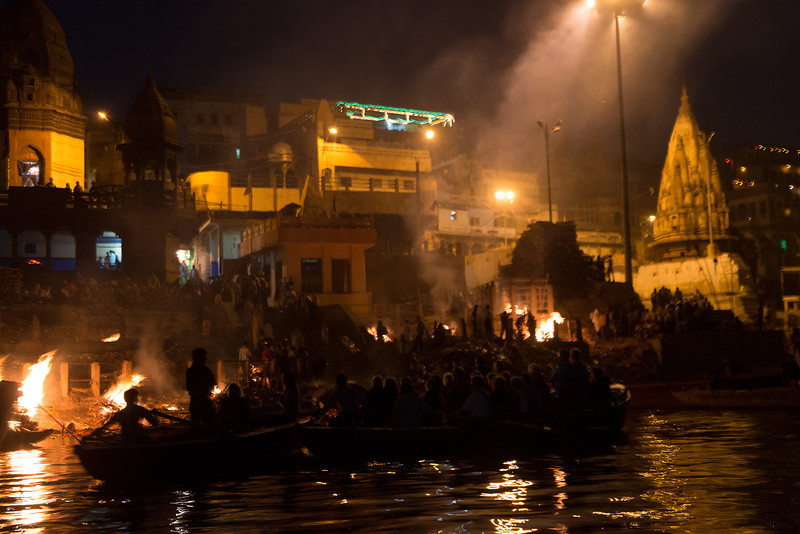 Night view of the cremation ghat on the Ganges in Varanasi. Taken from a long distance away out of respect for the tradition. The glowing fireplace on the extreme left side is the sacred flame that has been continuously burning for hundreds of years.