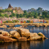 Women crossing a bridge in Orchha, early morning.
