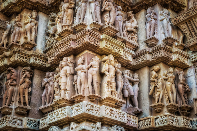 Detail from the exquisite sculptures that cover the temples in Khajuraho. The temples are also well-known for the erotic nature of some of the carvings. Seems Indian women were rather large-bosomed in those days.
