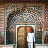 Detailed door inside the City Palace, Jaipur. Red turbans and mustaches are very popular in this region.