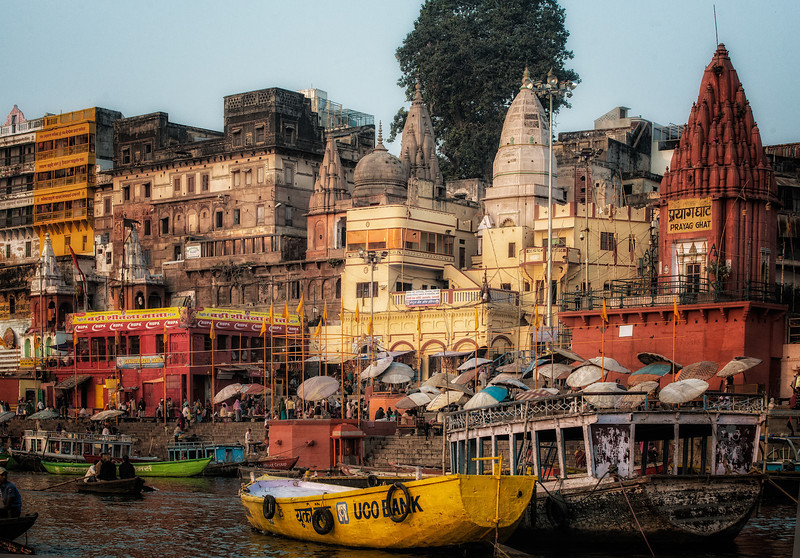 Early morning view along the Ganges, Varanasi. The umbrellas set up in the center are the site of negotiations with a brahmin priest concerning funeral arrangements for deceased family members.