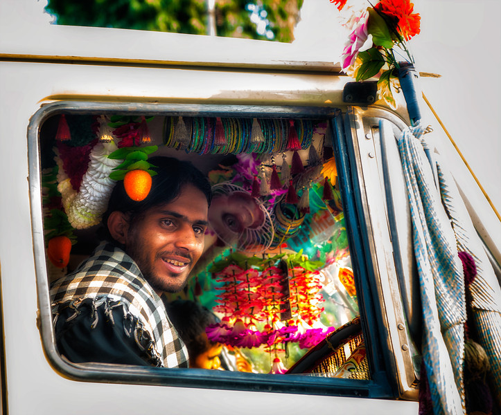 Street shot in Delhi. This guy had more decorations in his truck than many people had in their homes.