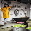 One of the cooks in the kitchen at the main Sikh temple in Delhi. The temple feeds 2500 or so people daily for free, using donated food, money and labor from the Sikh community.