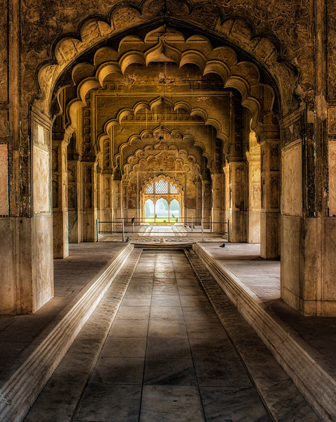 A room of the residential portion inside the Red Fort. There is a fountain in the center, and the channels were intended to be filled with flowing water.