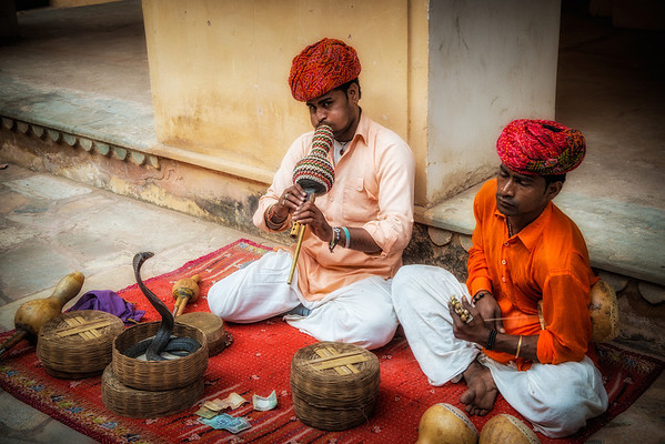 Snake charmers on the street in Jodhpur. Yes, the snakes are real, I saw them move.