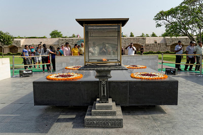 The black marble monument on the site of the funeral pyre of Mahama Ghandi.