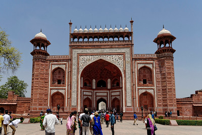 The gate to the Taj Mahal. On top there are 22 small pointed domes, one for each year of its construction. The inlaid white marble is the same as on each face of the Taj.
