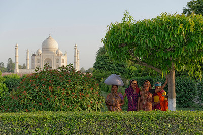 Some local colourful women, posing in front of the well known monument. Fifty rupees goes a long way to paying models in India.