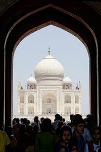 The first view one sees of the Taj is through the main gate, above the heads of the others there for the same purpose. There is a queue to take this picture from the very centre of the gate.