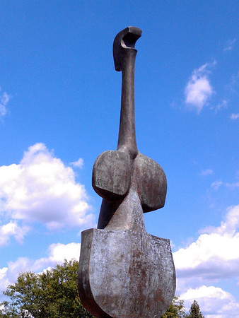 """Violin Woman"" sculpture by Harold R. Langland"